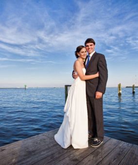 Wedding guest accommodations on waterfront vacation rentals showing bride and groom on one of our docks